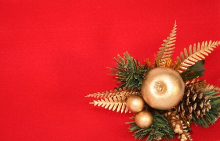 christmas decoration: green branch, cone, golden apple photo