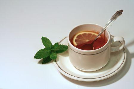 cup of tea with lemon and tea spoon photo