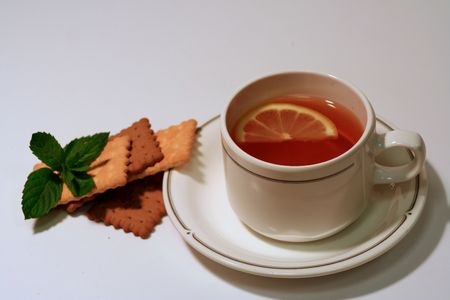 cooky: cup of tea with lemon and tea biscuits, cookies