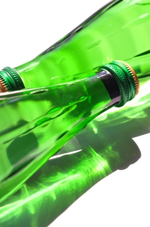 Two green bottles, isolated on a white background photo