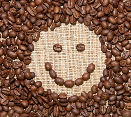 coffe break: coffee beans smile on burlap background Stock Photo