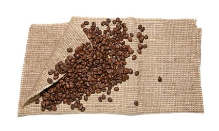 stimulated: the coffee beans on burlap on white background