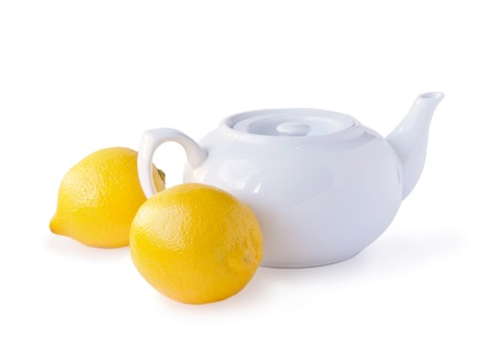 teakettle: white teakettle and two lemons isolated on a white background