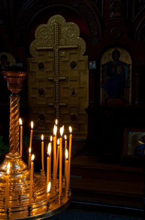 Crucifix and a lot of candles in church. The Church of the Ascension of Christ, Foros, Crimea