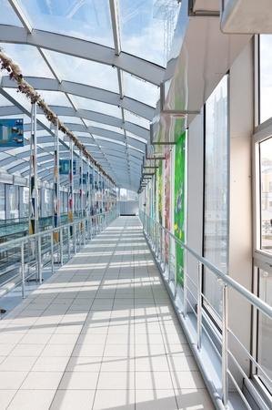 Modern glass corridor at railway terminal Stock Photo - 10496279