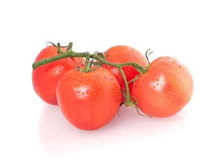 bunch of four red tomatoes isolated on a white background photo