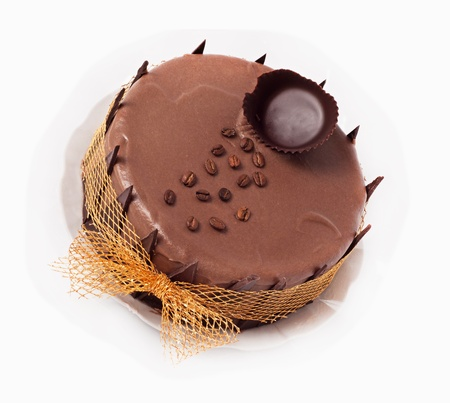 chocolate cake with coffee beans on white background, top view photo
