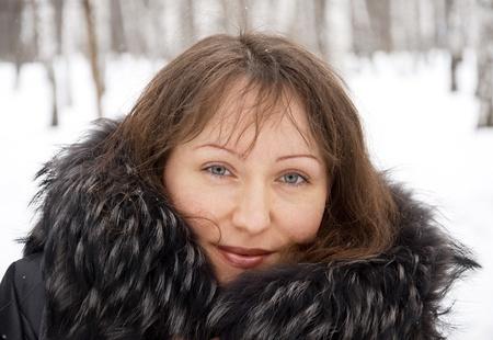 fur tree: Portrait of beautiful brunette woman in snow winter park