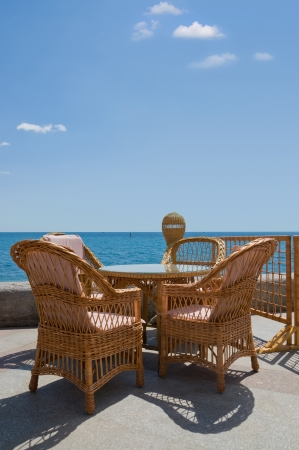 table and rattan chair by the sea  Yalta, Ukraine, Black Sea photo