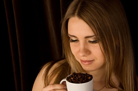 Beautiful young female with a coffee cup photo