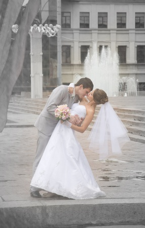 Bride and groom dancing in a street - outdoor photo