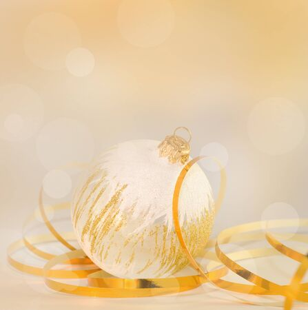 Christmas Bauble and gold ribbon, postcard  Beautiful background  photo