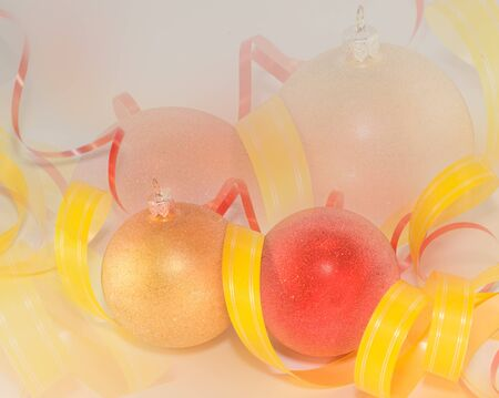 Christmas Bauble and yellow ribbon on color background photo