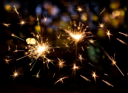 Holiday sparklers on colorful bokeh background Stock Photo - 15965665