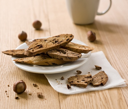 traditional Italian biscotti cookies and cup in the background