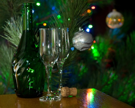 Two glasses and bottle of champagne against of lighted christmas tree Stock Photo - 16393871