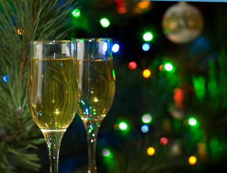Two glasses of champagne in front of christmas tree