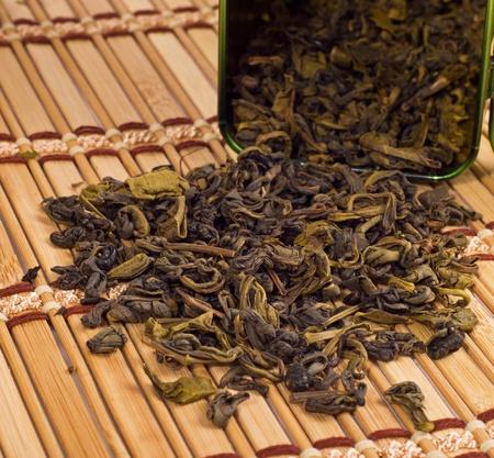 stimulated: green tea on bamboo mat background Stock Photo
