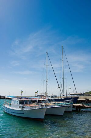 yachts on water on background the blue sky Stock Photo - 17974017