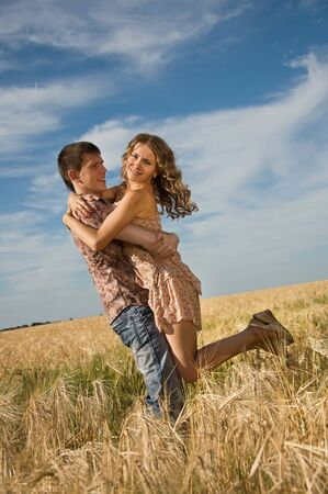 Happy young couple on field photo