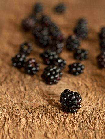 blackberry on old wooden table photo
