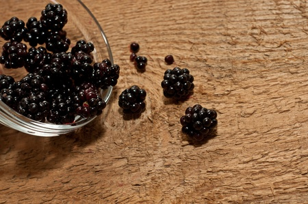 blackberry on old wooden table background photo