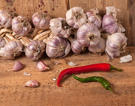 Garlic and pepper on wooden table photo