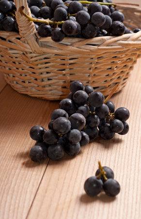 cabernet: Cabernet Grapes on wooden table Stock Photo