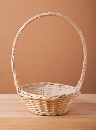 Empty basket on wooden table photo