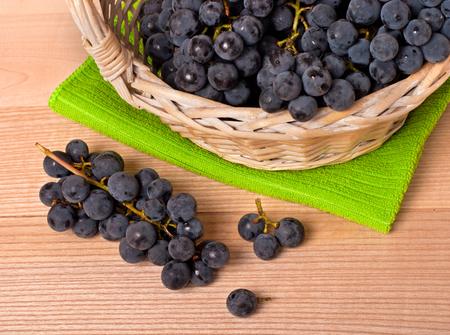 merlot: Merlot Grapes in basket on wooden table