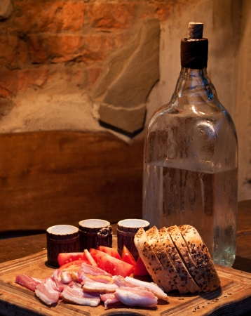 Vodka with bread, bacon and tomato photo