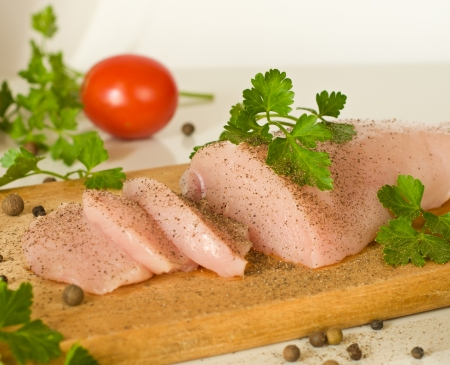 raw chicken breast fillet and pepper spices photo