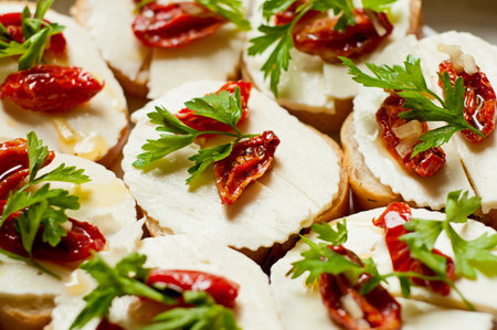 bread with dried tomatoes, mozzarella and parsley photo