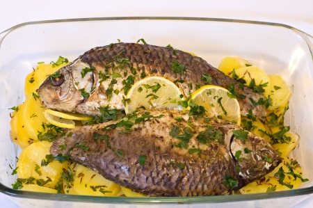 crucian: baked two crucian fish and potatoes