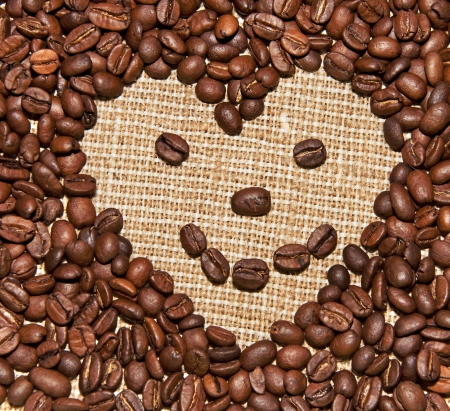 coffee beans heart on burlap  photo