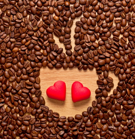 coffee beans cup and two red heart , love concept