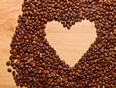 coffee beans heart on wooden, love concept photo