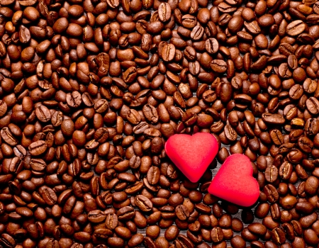 two red hearts on coffee beans, love concept photo