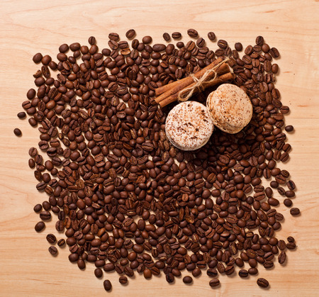 coffee beans and macaroons on wooden background photo