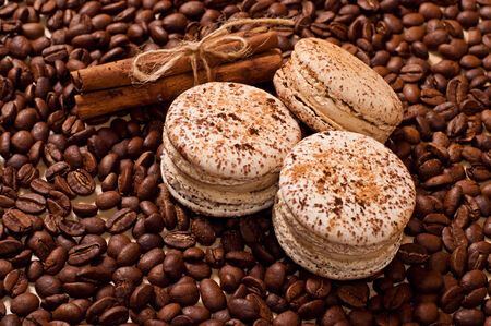 the coffee beans and three macaroons photo