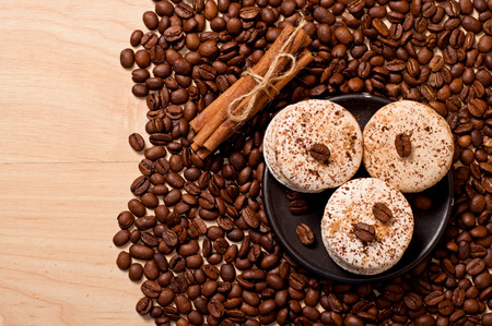 coffee beans, cinamon and macaroons, top view photo