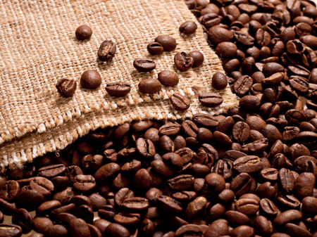 the coffee beans on burlap background photo