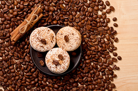 coffee beans, cinnamon and macaroons, top view photo