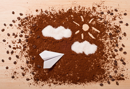 the coffee and paper airplane, top view. Travel concept photo