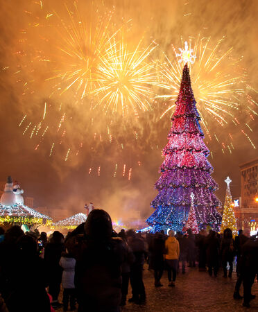 Christmas tree on a fireworks background in Kharkov  photo