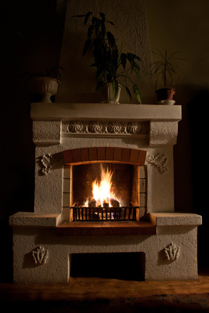 The Fire and firewood in old fireplace photo