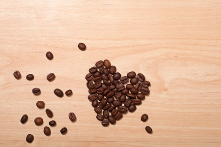 cofe: coffee beans heart on wooden background