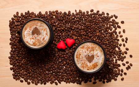 coffee cups, beans and two red heart, love concept photo