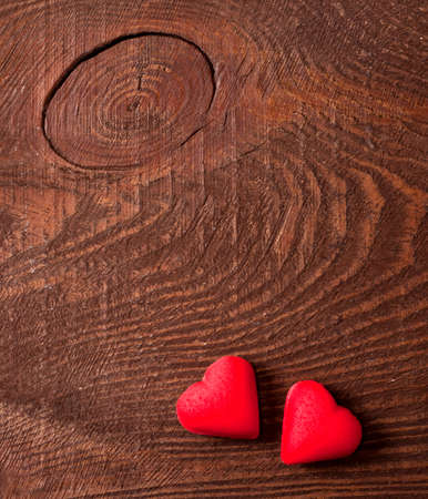 1 2 month: red hearts on wooden background, love concept Stock Photo