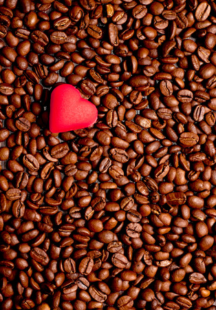 cofe: a red hearts on coffee beans background. Coffee love concept Stock Photo